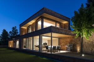 Hanghaus einfamilienhaus r this modern massivbau for Einfamilienhaus l form